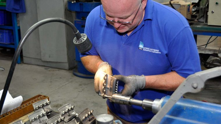 Man in protective gloves doing close up metalwork
