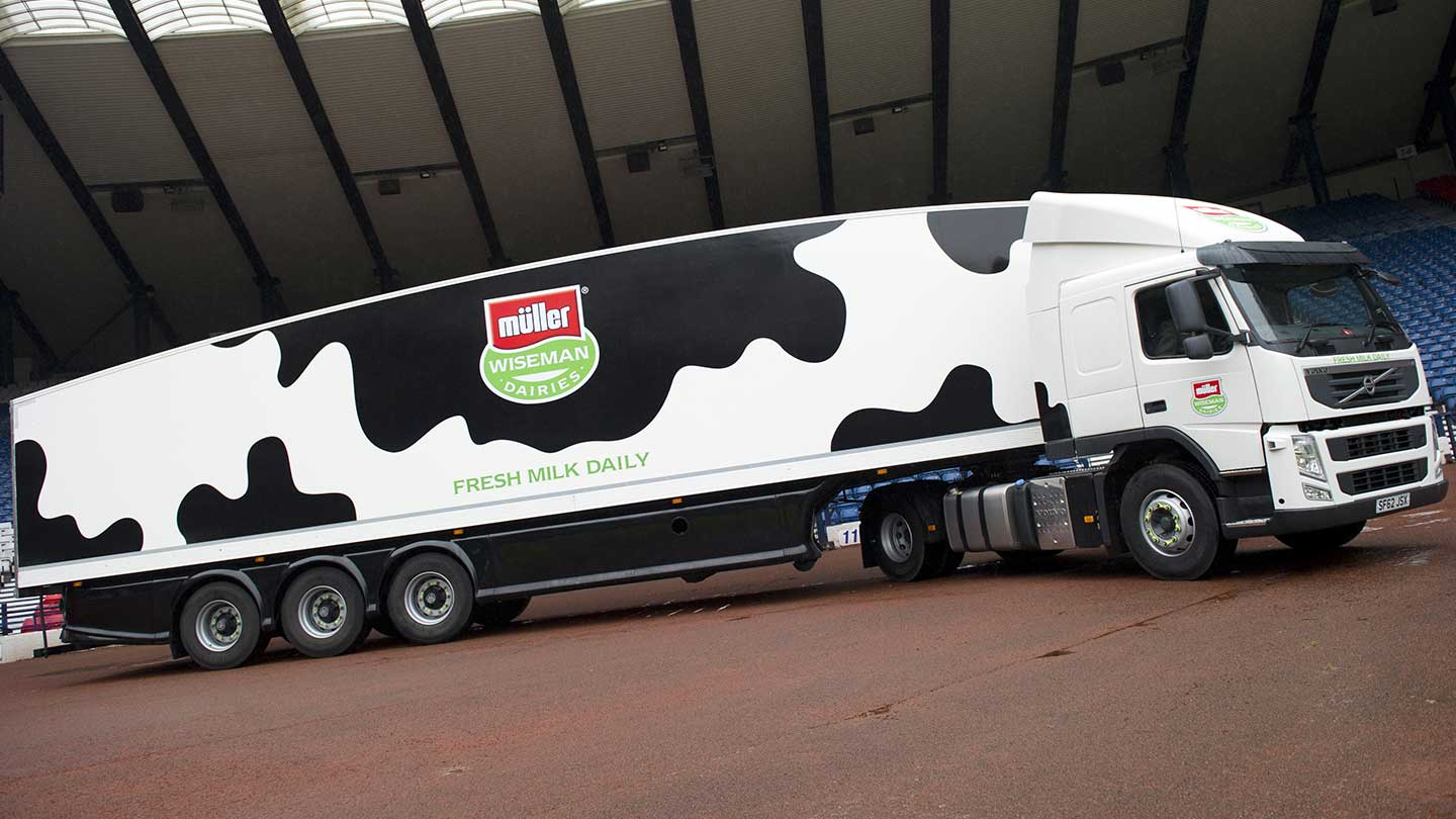 Muller branded lorry with cow pattern print