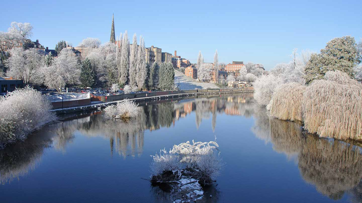 River Severn in foreground with Shrewsbury in background on a frosty day