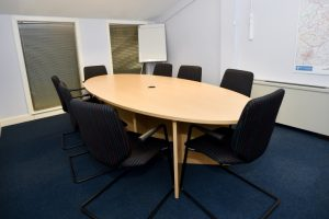 Board room table and chairs in office setting