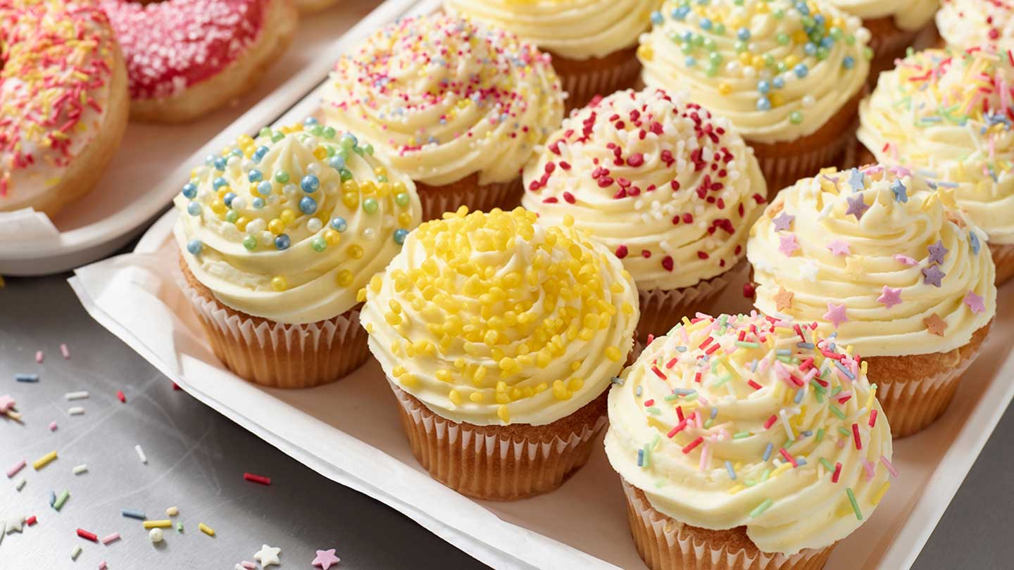 cupcakes on a tray with colourful sprinkles